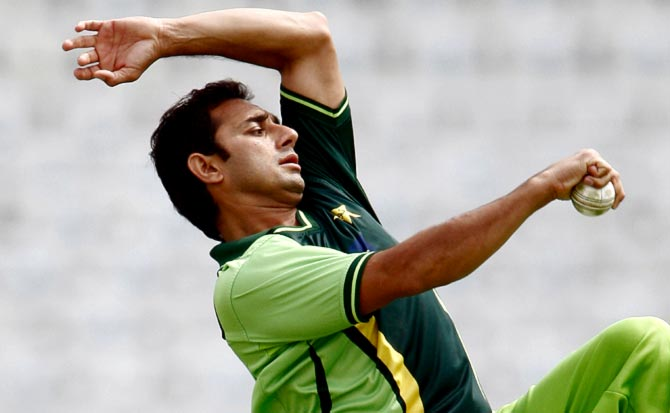 Rediff Cricket - Indian cricket - Pakistan trying hard to get Ajmal cleared for World Cup