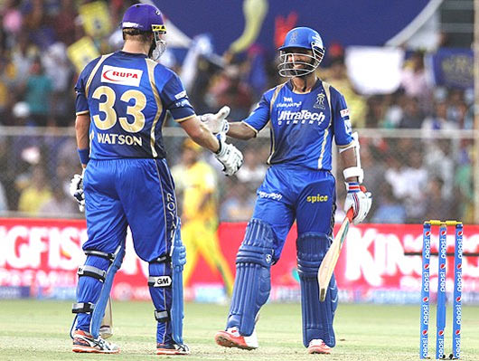 Rajasthan Royals player Ajinkya Rahane congratulates his captain Shane Watson after scoring a fifty