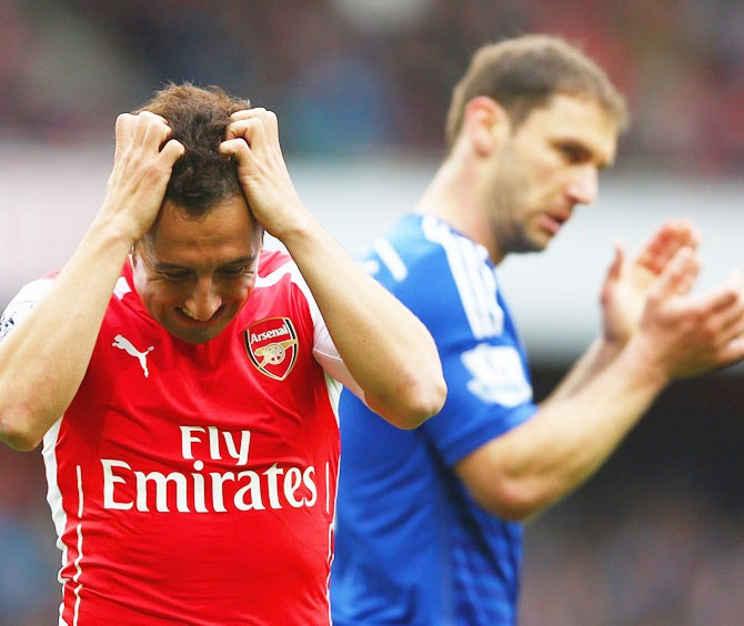 Santi Cazorla (left) of Arsenal reacts after a missed chance