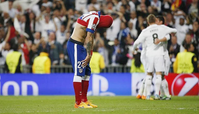 Atletico Madrid's Jose Maria Gimenez is dejected at the end of their Champions League second leg quarter-final against Real Madrid on April 22