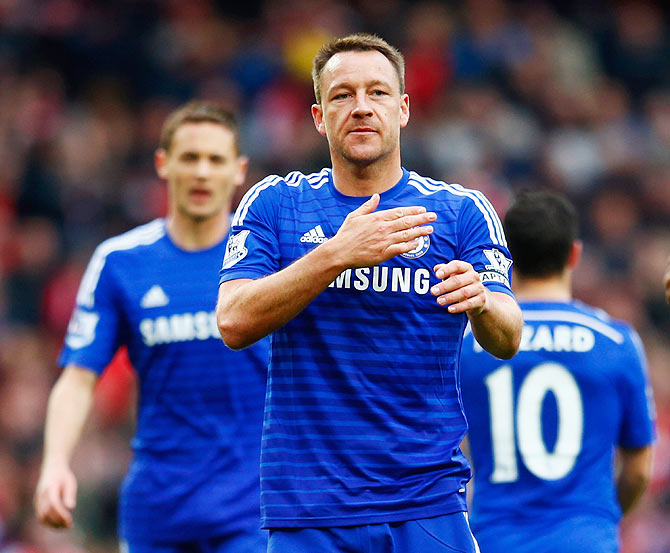 Chelsea's John Terry celebrates with teammates after holding Arsenal to a draw during their English Premier League match at Emirates Stadium in London on Sunday