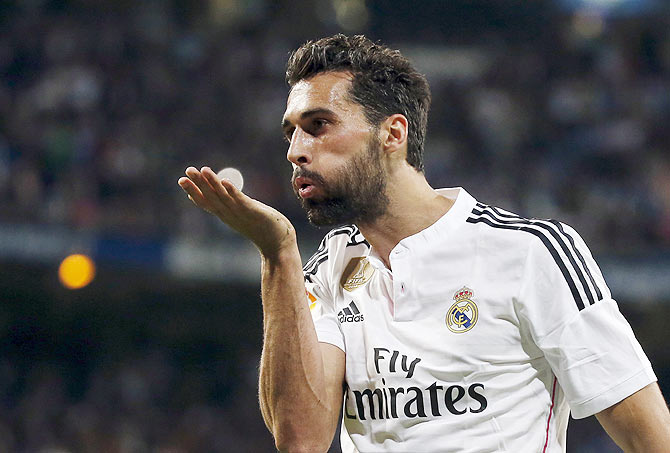 Real Madrid's Alvaro Arbeloa blows a kiss as he celebrates after scoring against Almeria
