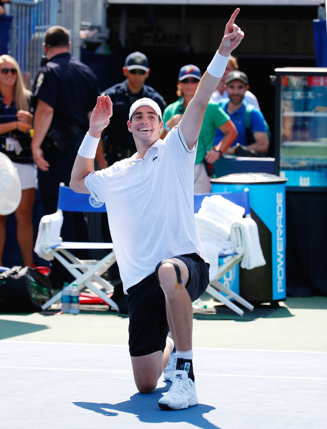 American John Isner reacts after defeating Cypriot Marcos Baghdatis during the BB&T Atlanta Open Final at Atlantic Station in Atlanta, Georgia, on Sunday