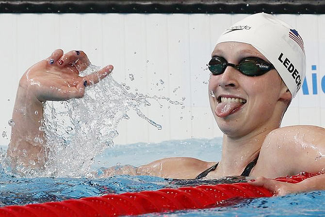Katie Ledecky from US celebrates after setting a new World Record in the women's 1500m freestyle heats at the Aquatics World Championships in Kazan, Russia