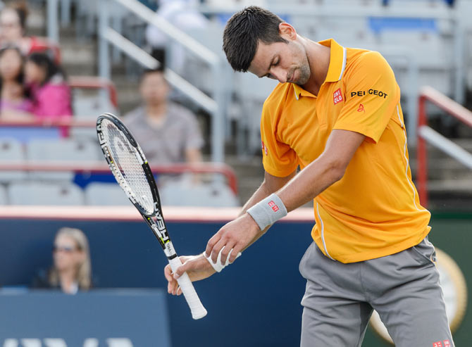 Novak Djokovic reacts after losing a point against Thomaz Bellucci