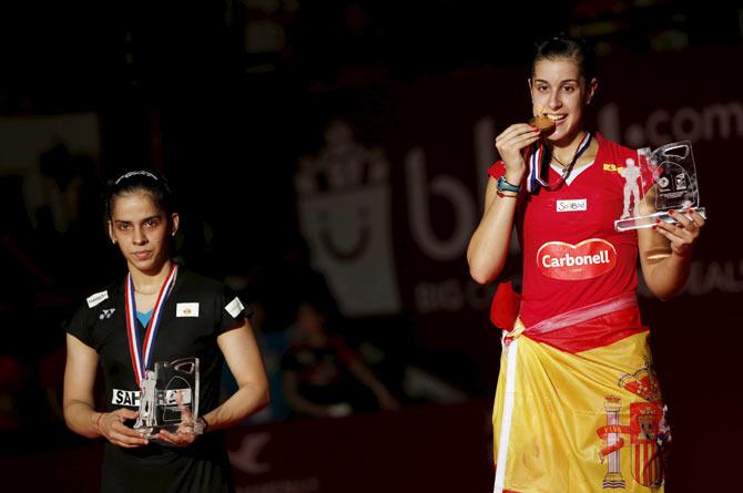 Saina settles for silver, loses to nemesis Marin at World Badminton