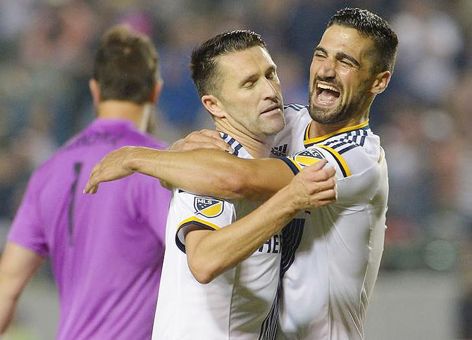 Los Angeles Galaxy midfielder Sebastian Lletget (17) celebrates after forward Robbie Keane (7) scored his third goal of the game in the second half against Toronto FC at StubHub Center in Carson, California on Saturday