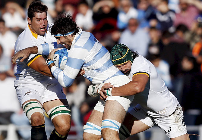 Argentina's Juan Martin Fernandez Lobbe (centre) is tackled by South Africa's Willem Alberts (left) and Victor Matfield during their rugby union Test match in Buenos Aires, Argentina on Saturday, August 15