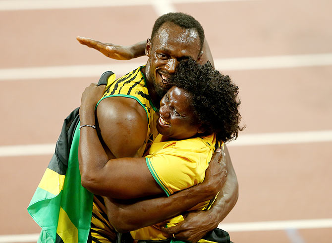 Jamaica's Usain Bolt celebrates with his mother Jennifer Bolt after winning gold in the Men's 100 metres final on Day 2 of the 15th IAAF World Athletics Championships at Beijing National Stadium in Beijing, China on Sunday, August 23