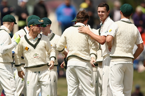 Josh Hazlewood of Australia and teammates embrace after winning the first Test against the West Indies in Hobart
