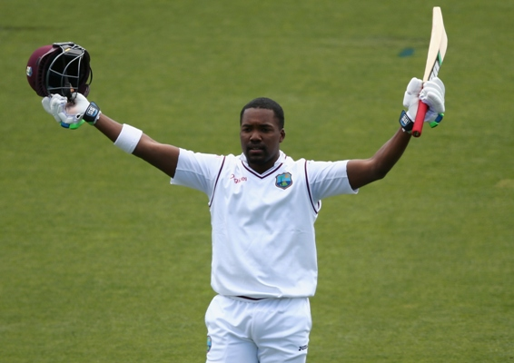 Darren Bravo of the West Indies celebrates after reaching his century