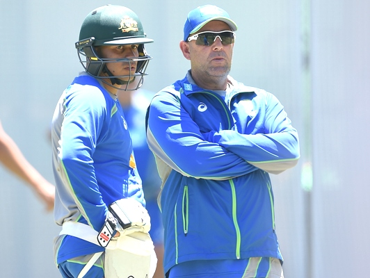 Australia coach Darren Lehmann speaks to Usman Khawaja during a nets session