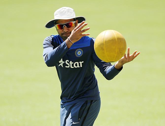 Rohit Sharma warms up during an India training session