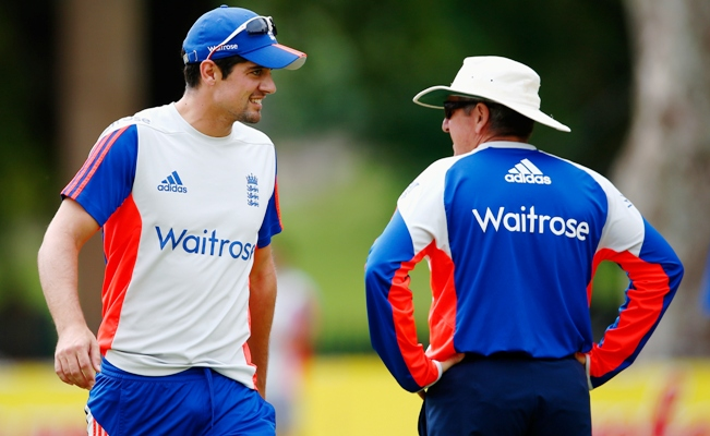 Coach Trevor Bayliss with Alastair Cook of England during a training session