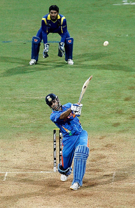 Indian cricket captain Mahendra Singh Dhoni hitting the winning six in the World Cup final