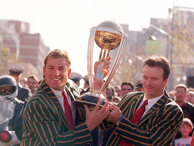 Shane Warne and Steve Waugh hold the World Cup Trophy during a ticker-tape parade through Melbourne, in celebration of the Australian Cricket team's victory over Pakistan in the 1999 Cricket World Cup final at Lords Cricket Ground, London