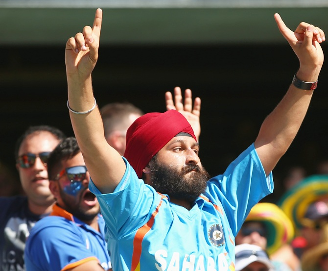 An Indian supporter in the crowd enjoys the atmosphere