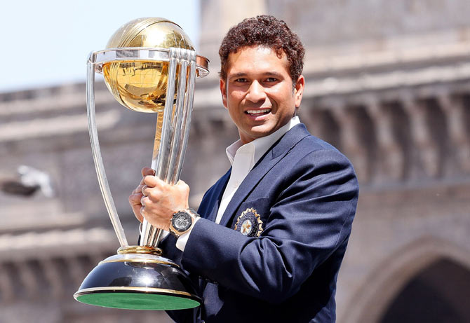 Sachin Tendulkar poses with the ICC Cricket World Cup Trophy, at the Gateway of India at the Taj Palace Hotel, in Mumbai on April 2, 2011
