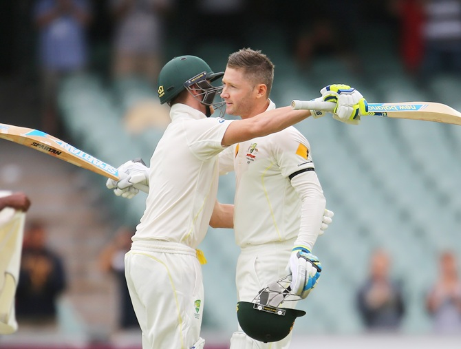 Australia captain Michael Clarke is congratulated by Steven Smith