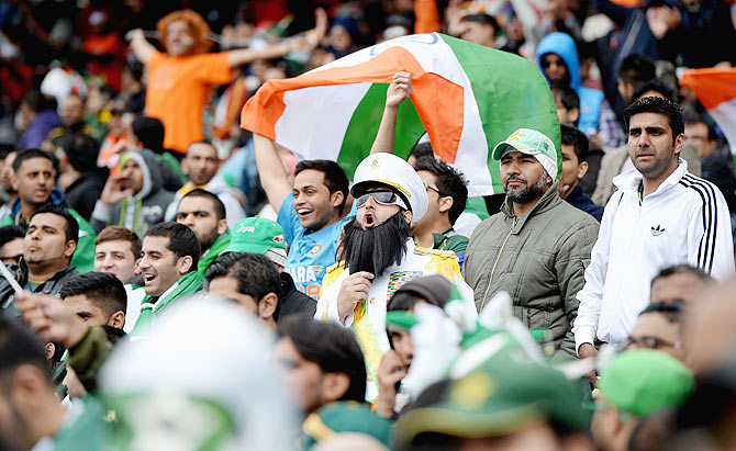 Pakistan and India fans cheer during the ICC Champions Trophy match between India and Pakiatan in June 2013