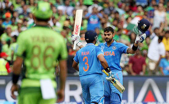 Virat Kohli celebrates with Suresh Raina after hitting a century against Pakistan in the ODI World Cup, February 2015. Photograph: Vipin Pawar/Solaris Images