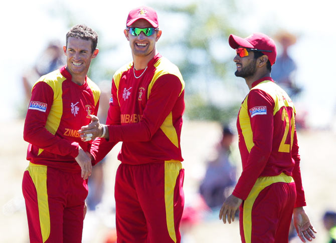 Sean Williams, Craig Ervine and Sikandar Raza of Zimbabwe celebrate the wicket of Shaiman Anwar of the United Arab Emirates on Thursday