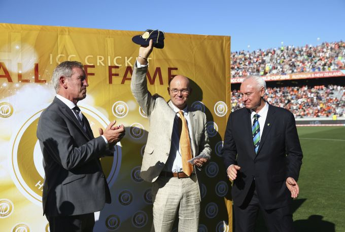 Martin Crowe, former New Zealand captain is inducted into the ICC Cricket Hall of Fame by ICC Director and Chairman of Cricket Australia, Wally Edwards during the World Cup match between Australia and New Zealand on February 28, 2015