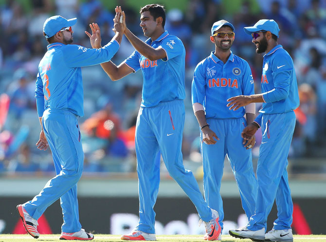 Rediff Cricket - Indian cricket - PHOTOS: Ashwin's career best haul helps India ease past UAE