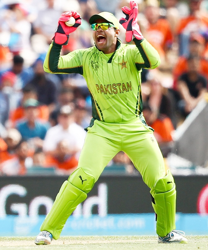 Rediff Cricket - Indian cricket - The strange case of Umar Akmal's gloves!