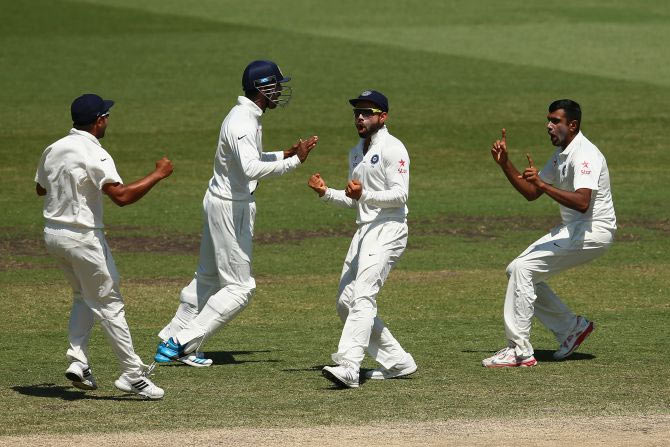 Test Captain Virat Kohli, second from right, and Ashwin, right, work in tandem to bamboozle the opposition. Photograph: Cameron Spencer/Getty Images