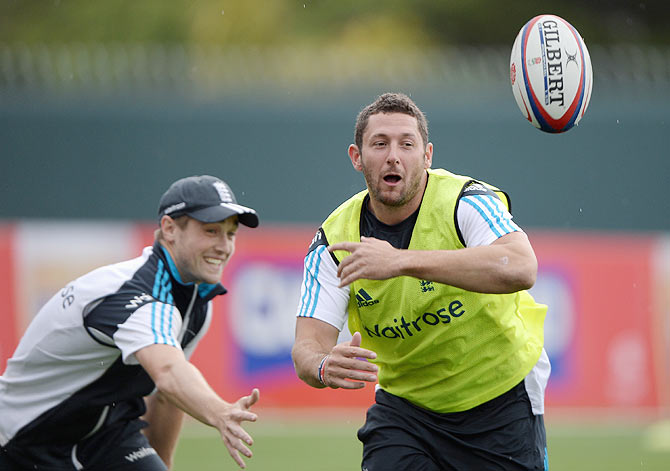 Tim Bresnan of England plays touch rugby with Chris Woakes during a nets session at Bellerive Oval in Hobart on Thursday