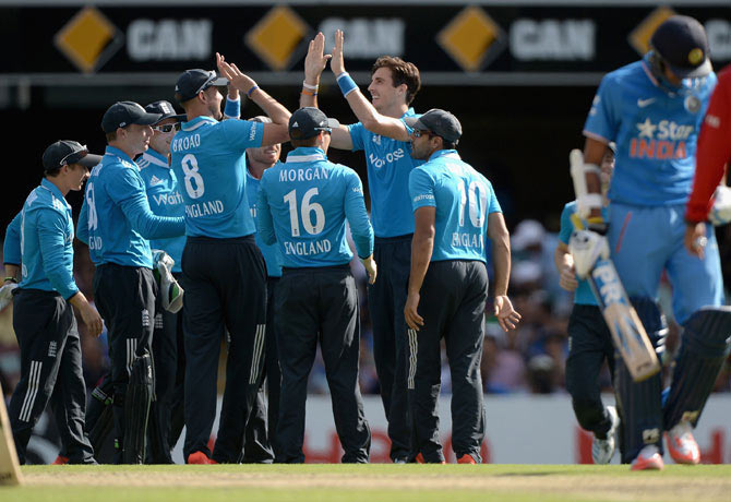 Steven Finn of England celebrates with teammates after dismissing Axar Patel of India at The Gabba on Tuesday