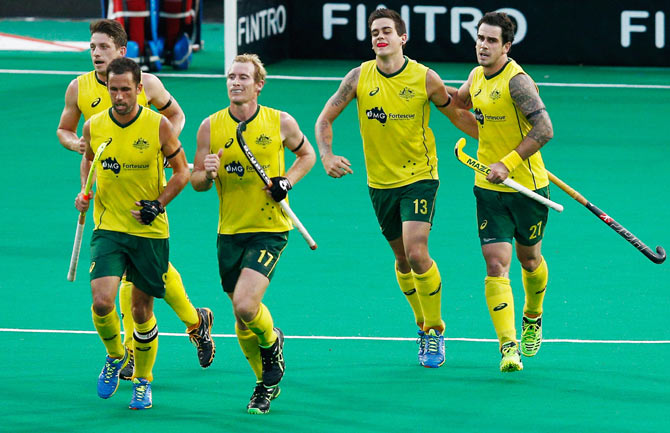 Australia hockey players celebrate