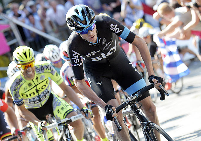 Team Sky rider Chris Froome of Britain climbs during the 159,5 km (99 miles) third stage of the 102nd Tour de France cycling race from Anvers to Huy, Belgium, on Monday