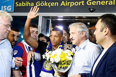 Nani acknowledges the crowd on arriving in Turkey on Monday after signing a three-year deal with Turkish club Fenerbahce