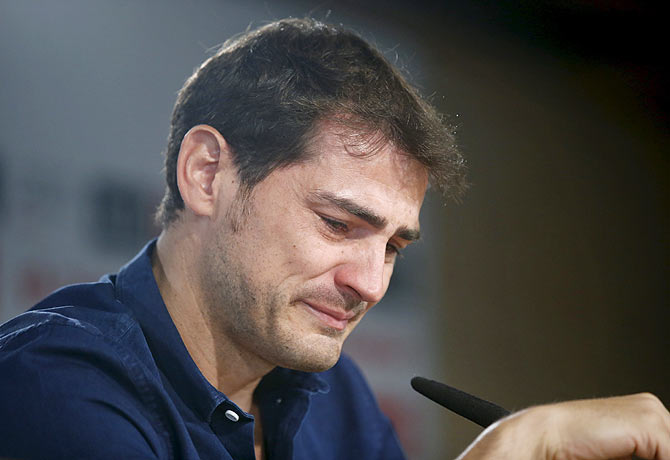 Real Madrid captain and goalkeeper Iker Casillas cries as he reads a statement announcing his departure from the Spanish club at the Santiago Bernabeu stadium in Madrid