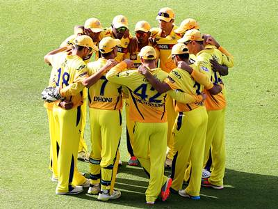 Chennai Super Kings players in a huddle before an IPL match