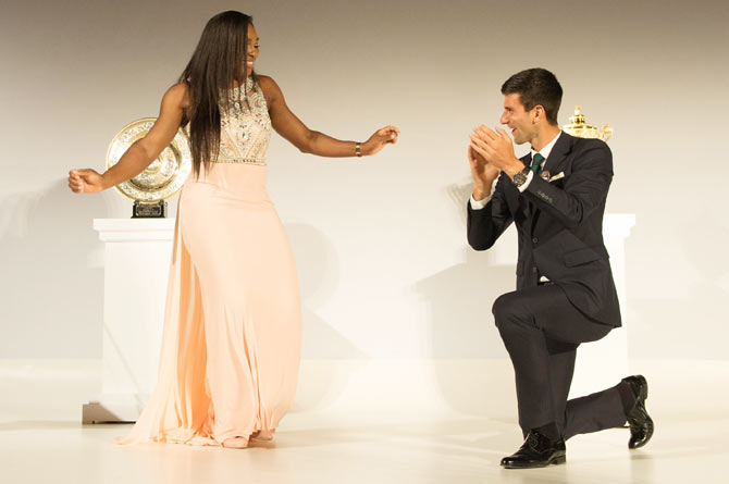 The United States'Serena Williams and Serbia's Novak Djokovic dance on stage at the Wimbledon Champions Dinner, at the Guild Hall, in London, on Sunday, July 12