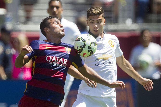 Manchester United's Andreas Pereira (right) challenges Barcelona's Pedro