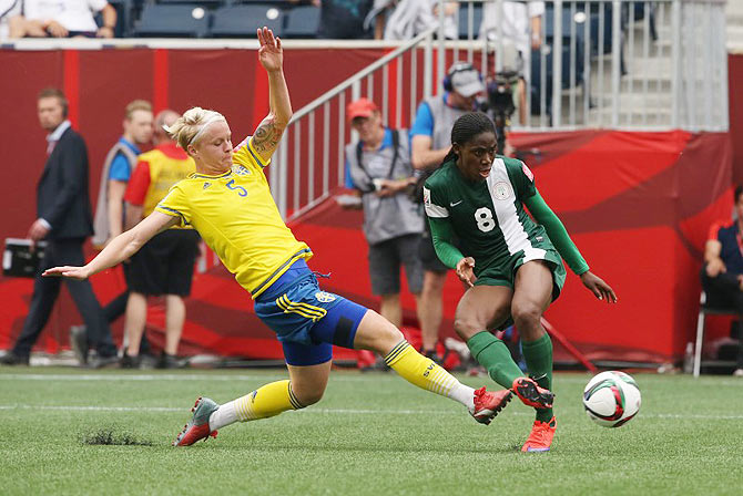 Nigeria forward Asisat Oshoala (8) scores past Sweden defender Nilla Fischer (5) in their Group D match at the 2015 women's World Cup at Winnipeg Stadium on Monday