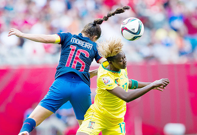 Cameroon's Gaelle Enganamouit (right) and Ecuador's Ligia Moreira battle for the ball during their FIFA Women's World Cup Group C match at BC Place Stadium in Vancouver, British Columbia, Canada, on Monday
