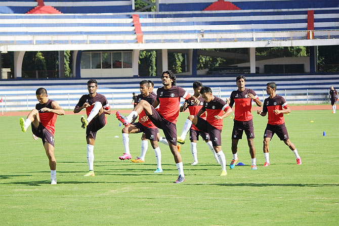 India's Sandesh Jhinghan (centre) leads the team at a traning session