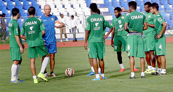 Oman coach Paul Le Guen talks to players during training session in Bengaluru on Tuesday