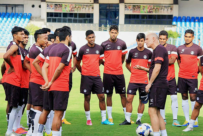 Indian football team coach Stephen Constantine speaks with his wards at the at the Kanteerava Stadium in Bengaluru on Tuesday