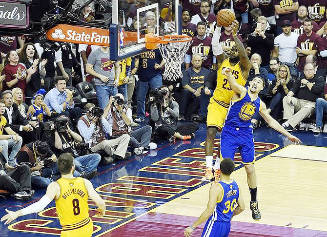 Cleveland Cavaliers forward LeBron James (23) dunks the ball over Golden State Warriors guard Klay Thompson (11) in game three of the NBA Finals at Quicken Loans Arena in Cleveland, Ohio on Tuesday