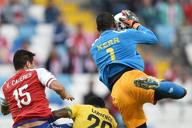 Jamaica's goalkeeper Duwayne Kerr clears the ball in a goal-mouth melee
