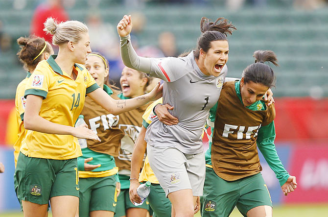 Australia players Alanna Kennedy, Lydia Williams and Leena Khamis celebrate after their match against Sweden at Commonwealth Stadium in Edmonton, Alberta, Canada, on Tuesday