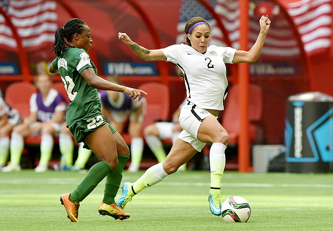Sydney Leroux of the United States (right) is challenged by Sarah Nnodim of Nigeria during their Group D match of the FIFA Women's World Cup in at BC Place Stadium in Vancouver, Canada, on Tuesday