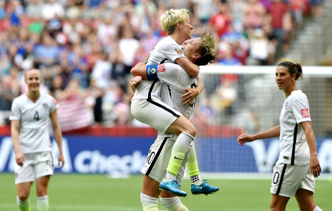United States' Abby Wambach (right) celebrates with teammate Megan Rapinoe after scoring to top US goal record list