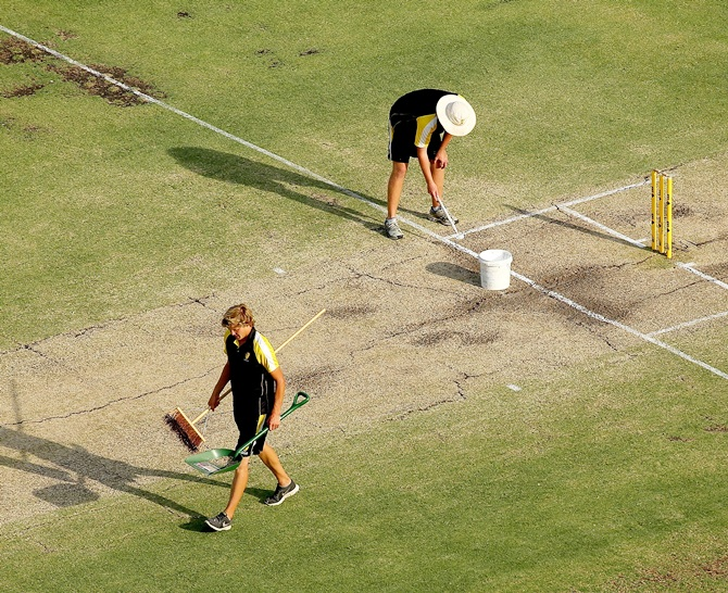 Groundsmen paint the crease at The WACA